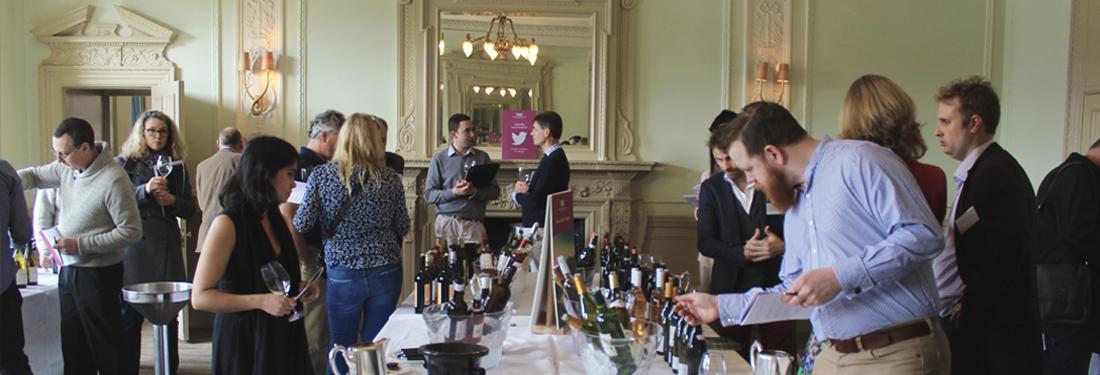 People tasting wine at event